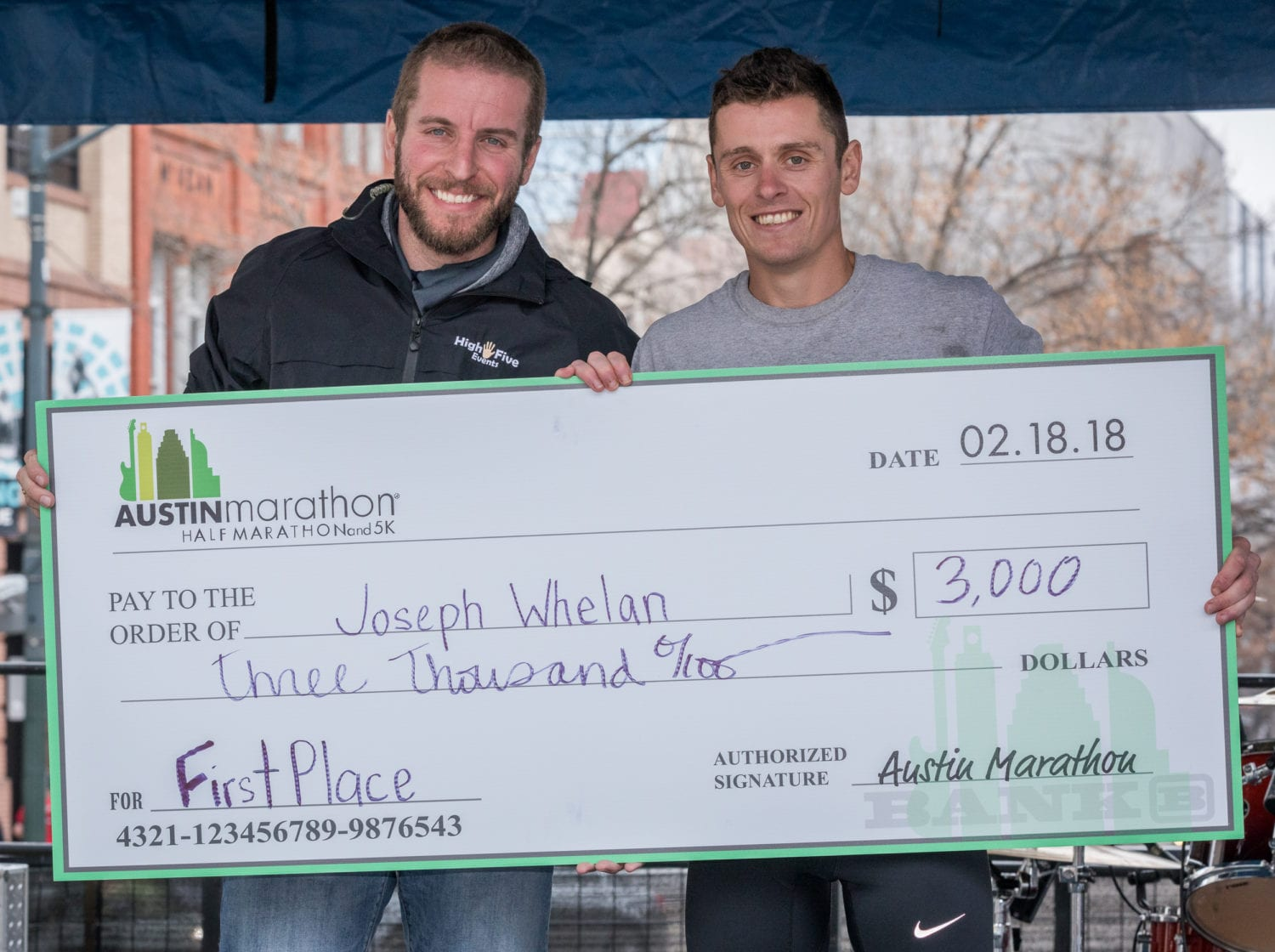 Joey Whelan accepts his Austin Marathon championship check.
