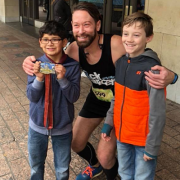 Chris Hartley delays prostate cancer surgery to run the 2018 Austin Marathon.